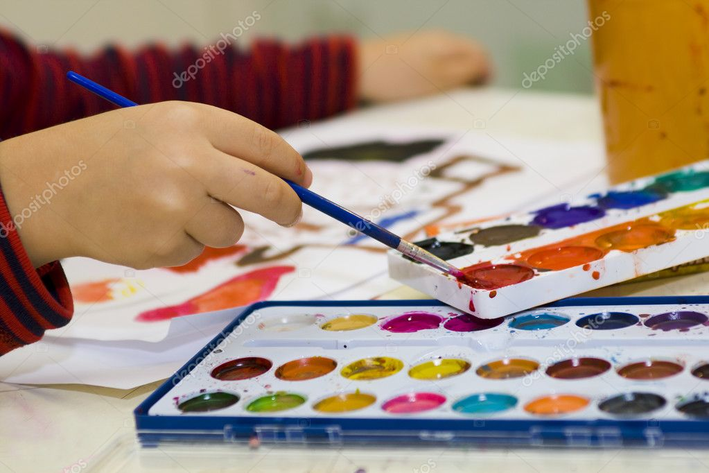 Hands Child mix watercolor paints — Stock Photo #2570506