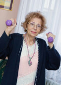 Senior woman exercise at home — Stock Photo