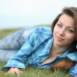 The beautiful girl on a grass — Stock Photo
