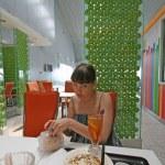 Girl in cafe interior — Stock Photo