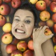 Girl in apples — Stock Photo #2565461