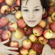Girl in apples — Stock Photo