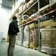 Men in big warehouse - Stock Photo