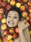 Girl in apples — Stock Photo