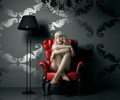 Woman in armchair — Stock Photo