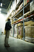 Men in big warehouse — Stock Photo