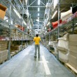 Man in storehouse - Foto Stock