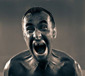 Screaming dirty man — Stock Photo