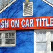 Stock Photo: Cash on Car Titles