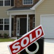 SOLD Sign in Front of Beautiful New Home — Stockfoto