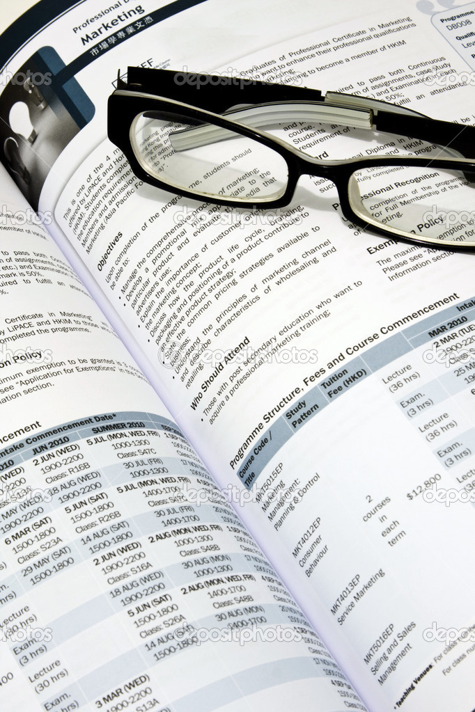 Glasses on book to present the idea that choose a course. — Stock Photo #2562020