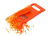 Carrots and grater — Stock Photo