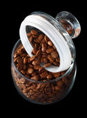 Coffee beans in a glass jar — Stock Photo