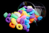 Colored elastics on black background — Stock Photo
