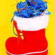 Red Christmas boot with gifts — Foto de Stock
