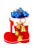 Red Christmas boot with gifts and bells — Stock Photo