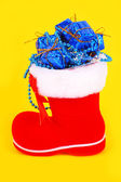 Red Christmas boot with gifts — Stock Photo