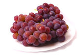 Grapes on the white plate — Stock Photo
