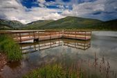 Mountain lake with pier. — Stock Photo