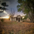 Small abandoned home in eastern Colorado - Stock Photo
