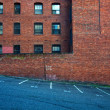 Stock Photo: Bricks, windows, and asphalt