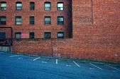 Bricks, windows, and asphalt — Stock Photo