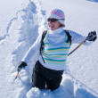Smiling woman on a snow path — Stock Photo