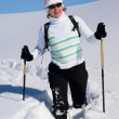 Smiling woman on a snow path — Stock Photo #2595199