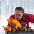 Man fanning fire in grill — Stock Photo #2595278