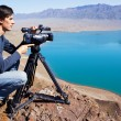 Stock Photo: Video operator removes desert lake