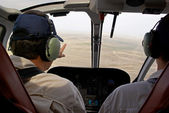 Pilots in helicopter cabin — Stock Photo