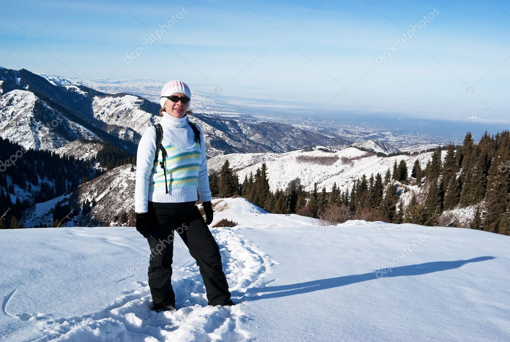 Woman on a snow path in the mountains — Stock Photo #2595128