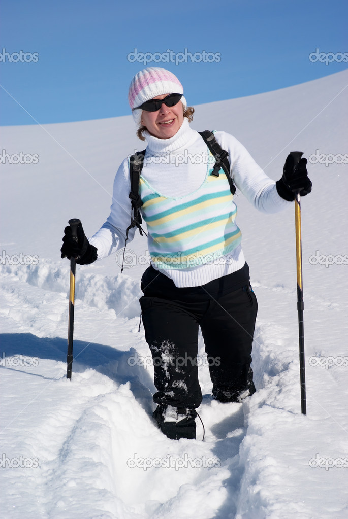 Smiling woman on a snow path in the mountains  Stock Photo #2595199