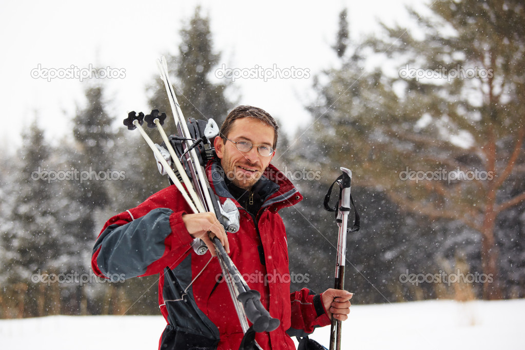 Skier portrait on ski resort and snowfall  Stock Photo #2598187