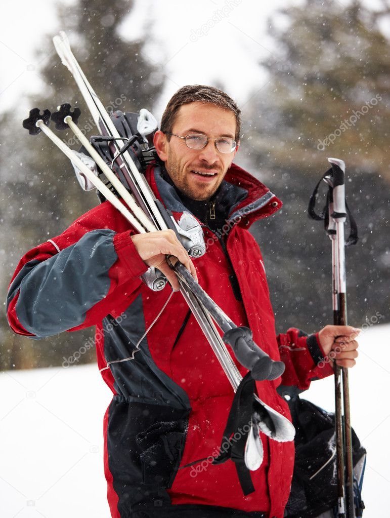 Skier portrait on ski resort and snowfall — Stock Photo #2598262