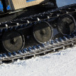 Stock Photo: Working Piste machine (snow cat) detail