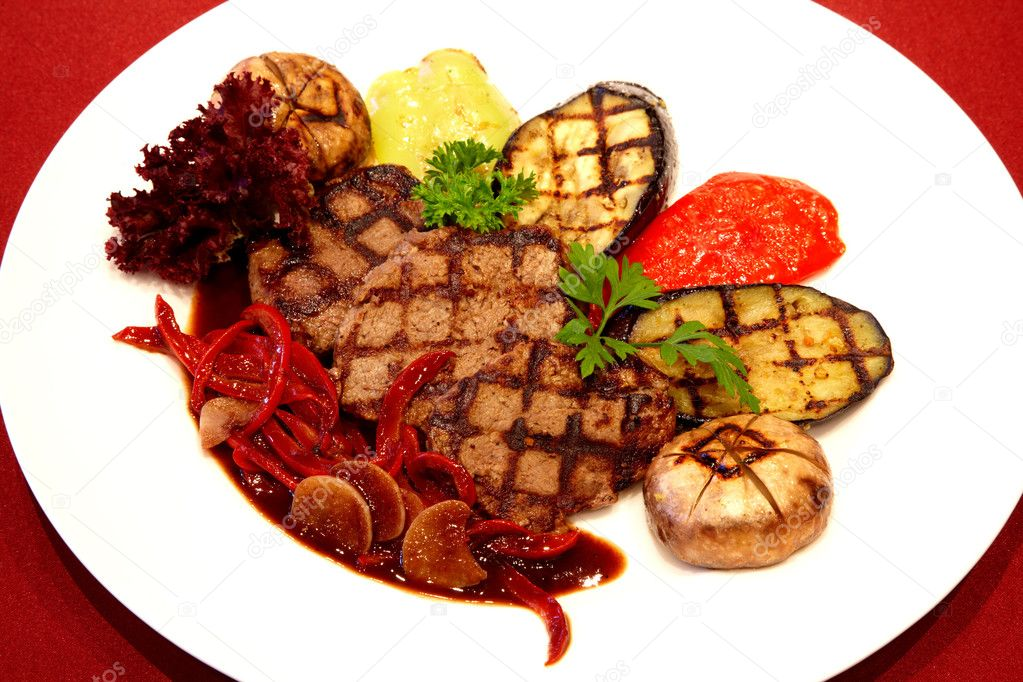 Gourmet grilled steak on red background — Stock Photo #2601112
