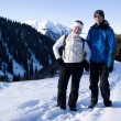 Smiling couple of backpackers — Stock Photo #2642494