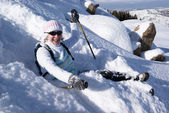 Smiling woman on a snow path in the mountains — Stock Photo