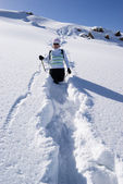 Woman on a snow path in the mountains — Stockfoto