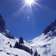Bright sun in winter mountains — Stock Photo