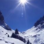 Bright sun in winter mountains — Stock Photo