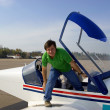 Stock Photo: Young man in small airplane