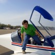 Young man in small airplane — Stock Photo