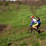 Speed motion mountain biker — Stock Photo