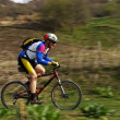 Speed motion mountain biker — Stock Photo