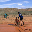 Bike race in desert mountains — Stock Photo
