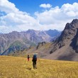 Stock Photo: Two peoples Hiking in mountains