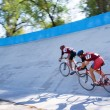 Stock Photo: Two cyclist fast racing on velodrome