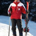 Skier portrait and snowfall — Stock Photo